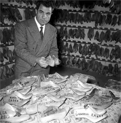 27th January 1956:  Italian shoemaker Salvatore Ferragamo (1898 - 1960) , who designs footwear for royalty and film stars, with lasts of all the shoes he has made in his shop in Florence.  (Photo by Enzo Graffeo/BIPs/Getty Images)