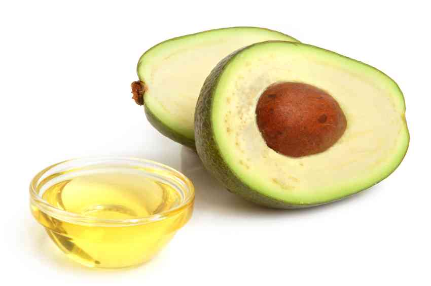 Avocado and vegetable oil on white background