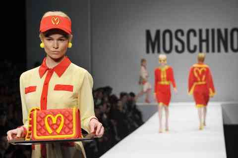A model presents a creation for fashion house Moschino as part of the Milan's Women's fashion week Autumn/Winter 2014 collections on February 20, 2014. AFP PHOTO / TIZIANA FABI        (Photo credit should read TIZIANA FABI/AFP/Getty Images)