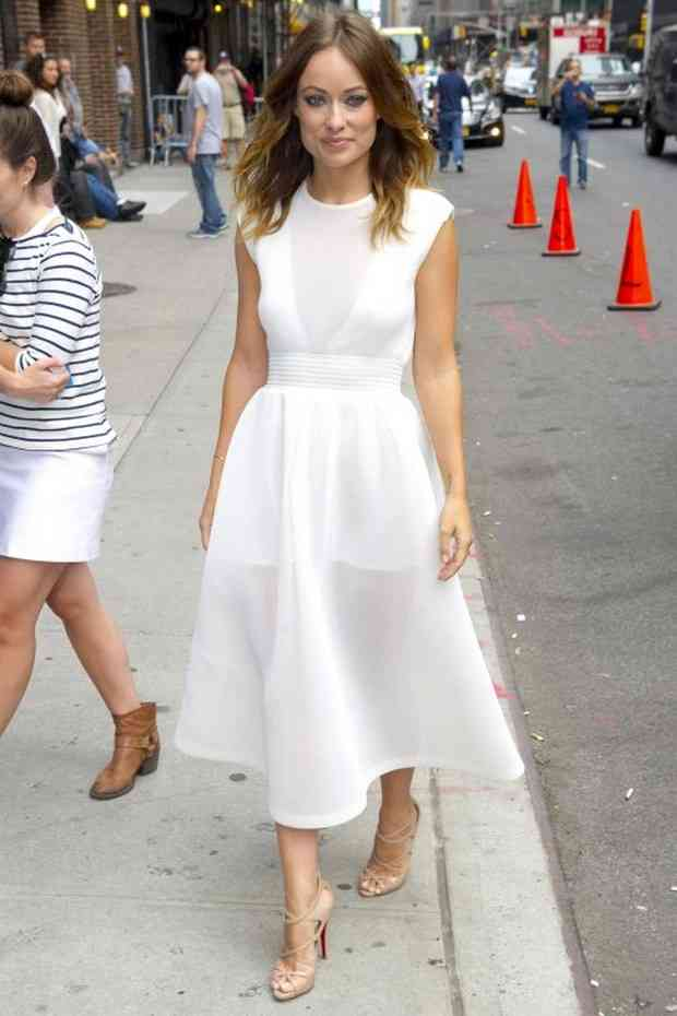 """New York, NY - Actress Olivia Wilde continues her busy day and heads to the studio for a taping of """"Late Show with David Letterman"""" in New York, promoting her new movie """"Drinking Buddies"""".  The brunette beauty dressed in a sheer white triangle shoulder dress with nude Christian Louboutin heels. AKM-GSI          August 19, 2013 To License These Photos, Please Contact : Steve Ginsburg (310) 505-8447 (323) 423-9397 steve@akmgsi.com sales@akmgsi.com or Maria Buda (917) 242-1505 mbuda@akmgsi.com ginsburgspalyinc@gmail.com"""